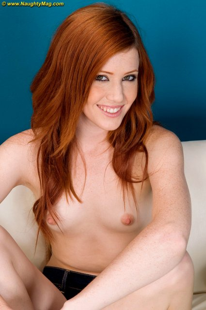 Рыжая шлюха с идеальным телом позирует для порно фото