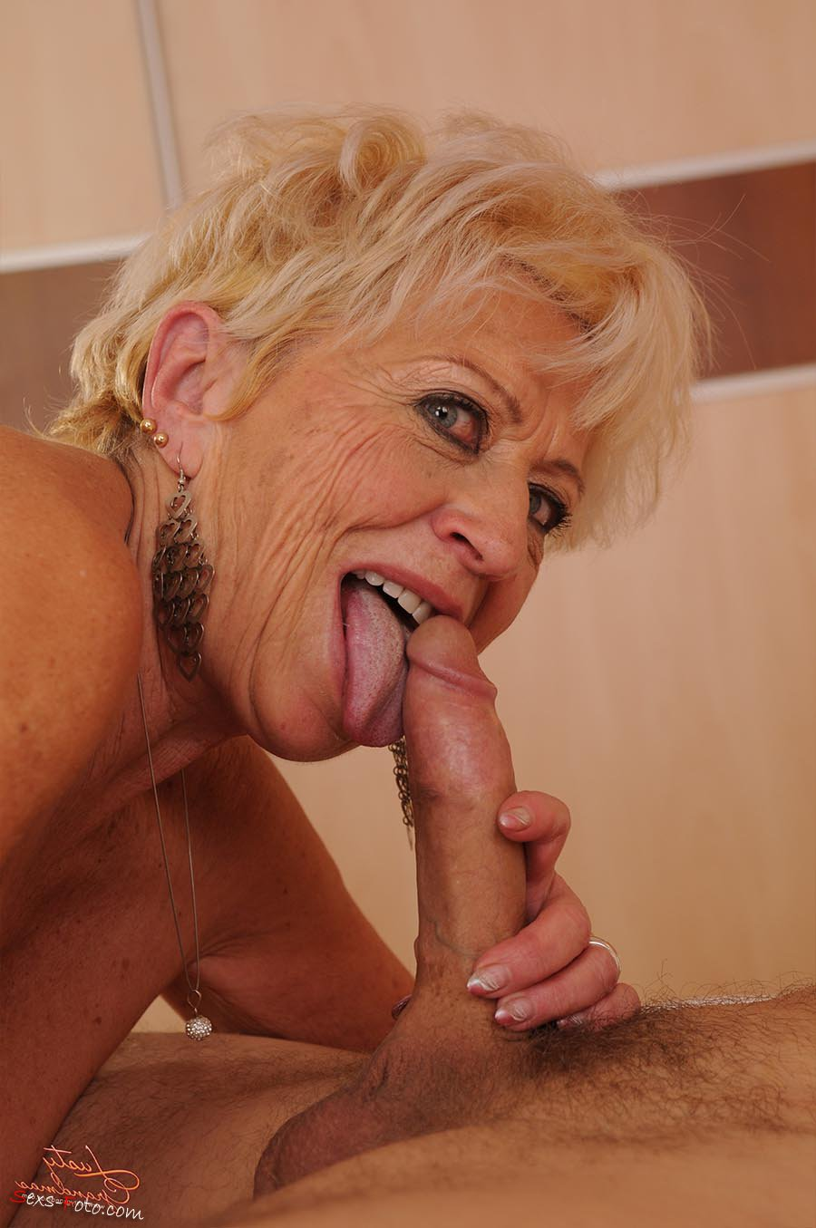 Blonde 50 year old sucks cock eagerly